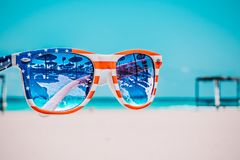 Focus Photography of American Flag-accent Wayfarer-styled Sunglasses With Sea Background royalty free stock images