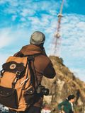 Focus Photography of Person Wearing Brown and Black Jacket With Brown and Black Backpack Royalty Free Stock Image