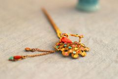 Focus Photography of Yellow and Multi-colored Hair Stick Stock Photography