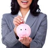 Focus on a piggybank. Against a white background Royalty Free Stock Photos