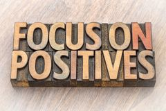 Focus on positives - word abstract in wood type Stock Photography