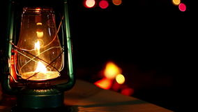 Focus pull from a lantern to a camp fire Royalty Free Stock Photography