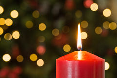 Focus on red christmas candle. At home in the living room Royalty Free Stock Photos