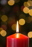 Focus on red christmas candle. At home in the living room royalty free stock photo