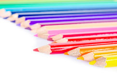 Focus at red colored pencil with many colored pencil on white ba Royalty Free Stock Image