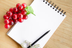 Focus red grape and blank white diary. Stock Photo