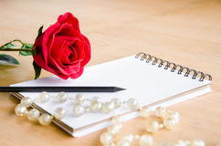 Focus red rose with blank diary Stock Photos