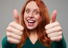Focus on redhead woman showing thumbs up royalty free stock photo