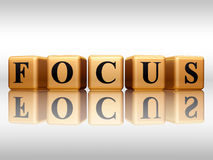 Focus with reflection. 3d golden cubes with text - focus, word, with reflection royalty free illustration