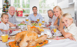 Focus on the roast turkey in front of family Royalty Free Stock Image