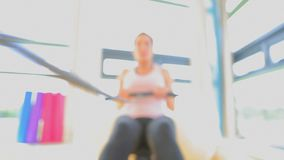 Focus on a row machine with a woman Royalty Free Stock Photography
