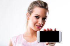 Focus on the screen of a smartphone held by a woman Stock Photography