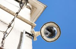 CCTV camera or surveillance system. Focus on security CCTV camera or surveillance system on building oin a city Royalty Free Stock Images