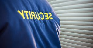 Focus on a security guard jacket near the blind Stock Photos