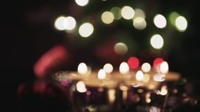 Focus shift from light dots over candles to star. Focus shifts from blurry lights to candles in focus to the cone and star in the background stock video footage