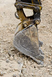 Focus shovel digging in dirt Stock Photo