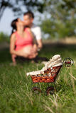 Focus small pram and young couple Royalty Free Stock Photos