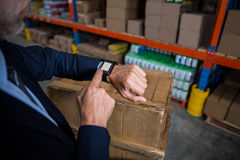 Focus on a smart watch. In a warehouse royalty free stock images