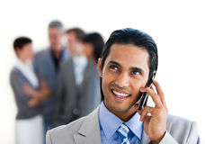 Focus on a smiling businessman on phone. Against a white background Royalty Free Stock Photos