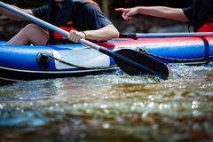 Focus some part of young person are rafting in river Royalty Free Stock Photography
