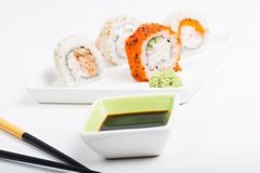 Focus on soy sauce, shushi rolls in back Stock Photo