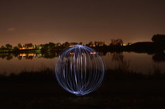Focus Sphere. On The Lake Side, and fling lights Stock Photography