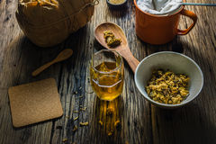 Focus Spot Chrysanthemum Tea and dried chrysanthemum on an old wooden table. Stock Photography
