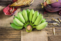 Focus Spot Cultivated banana and banana blossom on the table. Stock Image