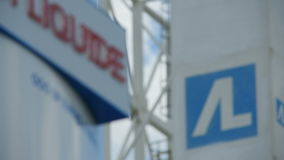 Focus from Stand with Brand Air Liquide to Logo on Tower. KAZAN, TATARSTAN/RUSSIA - AUGUST 06 2015: Focus changes from stand with brand name Air Liquide to blue stock video