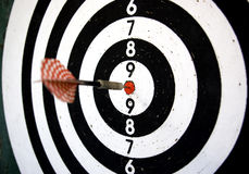 Focus on success. An arrow right on target stock photography