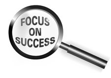 Focus on Success. An illustration or image showing a magnifying glass with the words Focus on Success as a statement contained within the lens section of the Stock Image