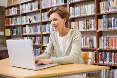 Focus teacher using laptop at library Stock Photo