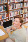Focus teacher using laptop at library Royalty Free Stock Photography