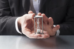 Focus on time management with hands holding a hourglass Stock Photography