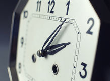 Focus on tips of hand with strong depth of field on an antique watch Stock Photos