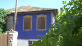 Focus to blur blue turks house in Thassos Greece stock video