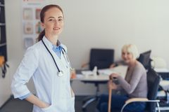 Positive general practitioner is seeing patient in the hospital stock photography