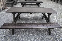 Tavern style forniture. Focus on wet old and awry wood tavern style table Stock Photography