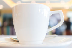 Focus on white tea cup with blurred background of conference bre Royalty Free Stock Images