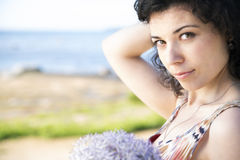 Focus of woman with dark hairs Royalty Free Stock Images