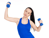 Young female with dumbbells Royalty Free Stock Images