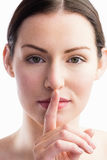 Focus on woman with her finger on mouth Stock Photography