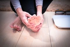 Focus on the women foot ankle injury/painful Stock Images