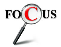 Focus word concept with magnifying glass Stock Photo