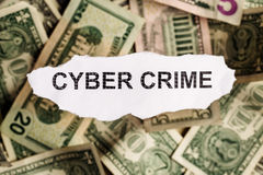 Focus on the word CYBER CRIME on piece of torn white paper with Stock Photo