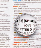 Focus on word love by magnifying a glass globe Royalty Free Stock Images