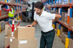 Focus of worker having a backache royalty free stock photography