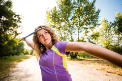 Focus - young woman throwing a javelin Stock Images