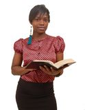 Focused. This is an image of a woman posing with a bible Stock Image