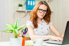 Focused accountant with glasses working on a computer Royalty Free Stock Photography